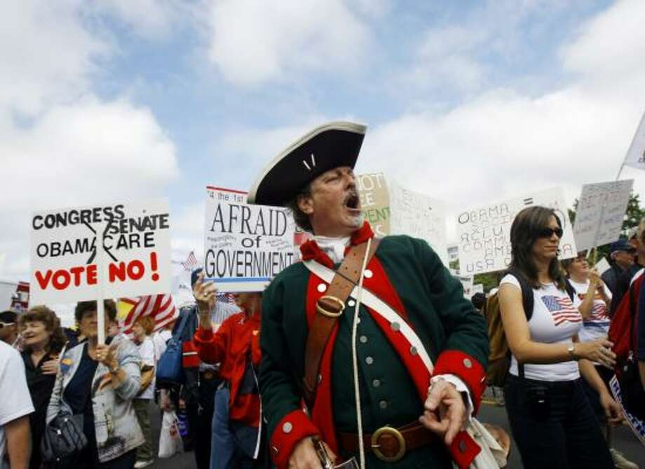 Demonstrators rally on Pennsylvania Avenue. Photo: Jose Luis Magana, Associated Press