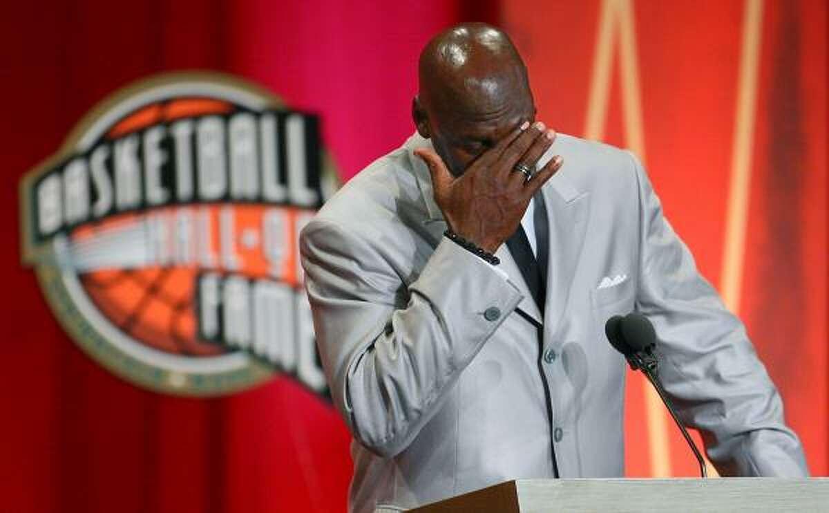 Former Chicago Bulls and Washington Wizards guard Michael Jordan becomes emotional as he takes the stage during his enshrinement ceremony into the Naismith Basketball Hall of Fame.