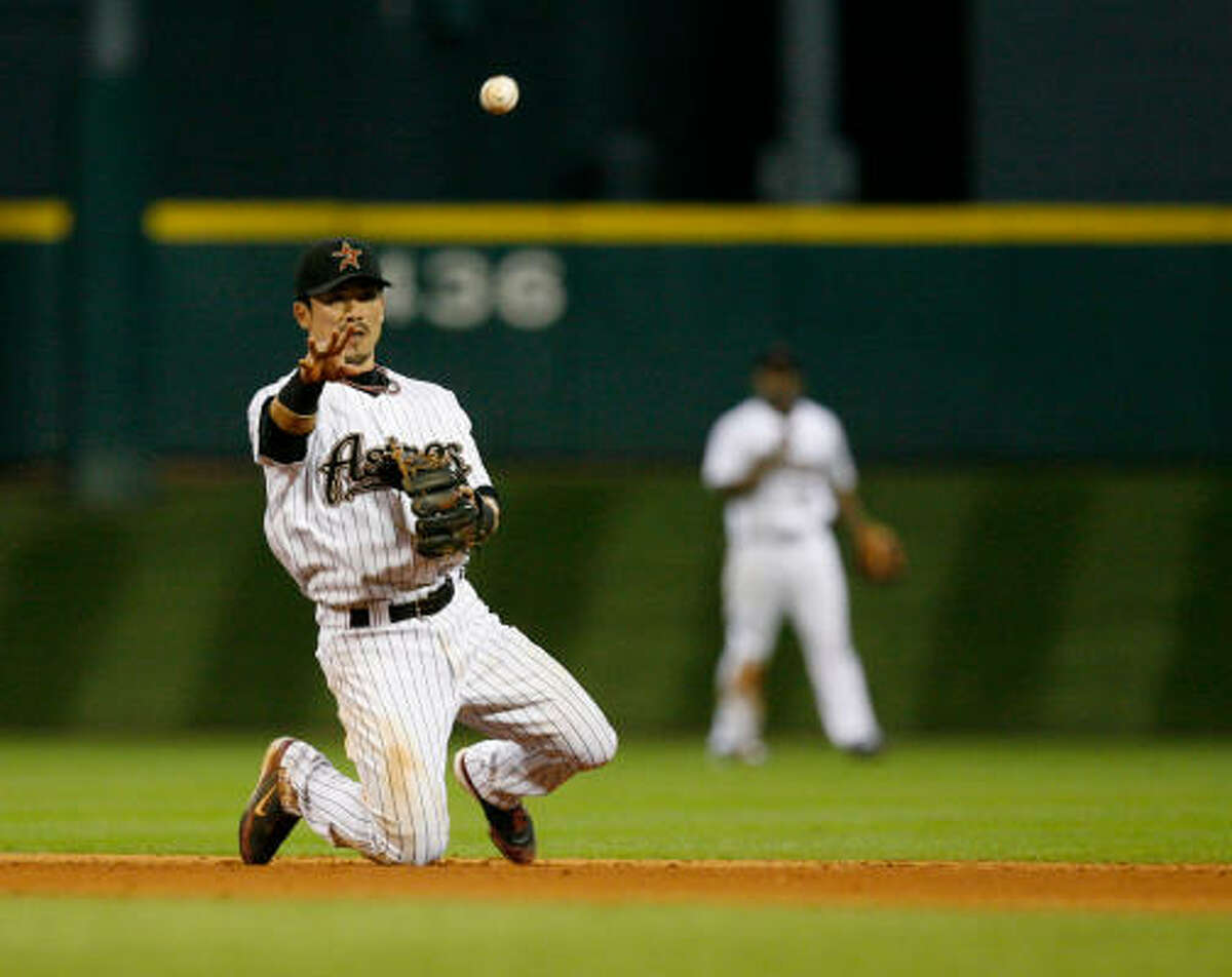 Astros second baseman Kazuo Matsui makes a play from his knees to throw out Atlanta's Nate McLouth (not pictured) in the fifth inning of Thursday's game at Minute Maid Park. The Astros lost 9-7.