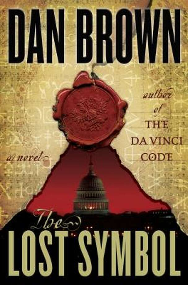 First of all there's the type on the front of the book:  Dan Brown   Author of The Da Vinci Code  The Lost Symbol  A novel   Which if you scramble the letters and apply a mirror effect on the 'w' reads:  Obama not Uhmerican  He robot  Lovvfe soshelicn  Anty-olddd