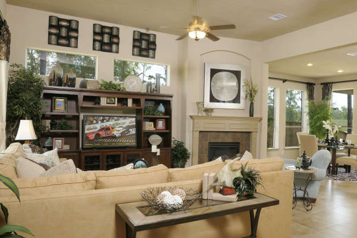 Pictured is the living room in Trendmaker's M831 design in The Woodlands' May Valley.