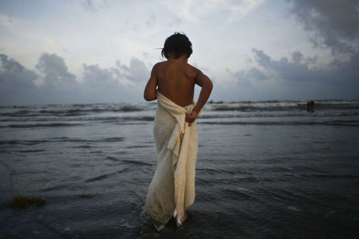 Back on the beach: Bryan Crooks, 4, wraps himself in a towel after a long day of swimming at West Beach.