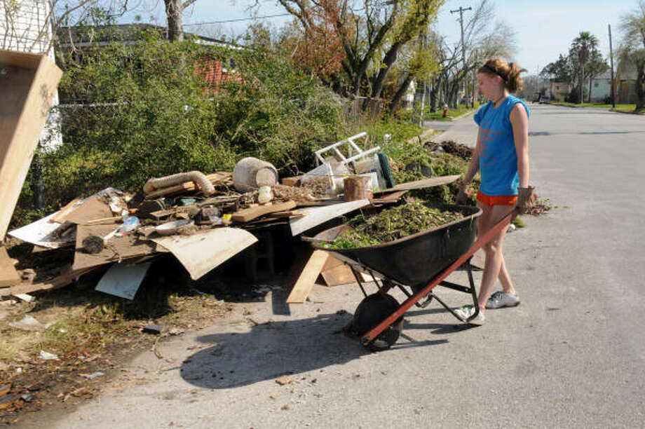 Amanda Gahler had wheelbarrow duty during the cleanup. Photo: Kim Christensen, For The Chronicle
