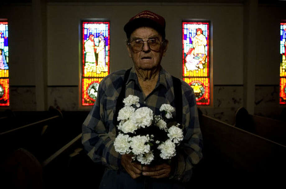 William O. Greb, 86, holds flowers used at his granddaughter's May 2008 wedding at Our Mother of Mercy Catholic Church. Greb's granddaughter was the last person to get married in the church, which was damaged in Hurricane Ike. Photo: Eric Kayne, Chronicle
