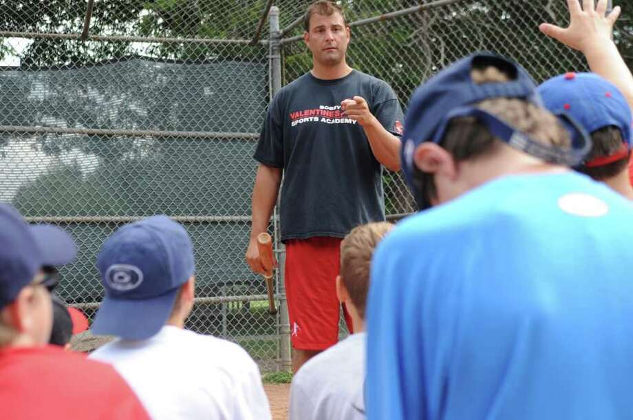 Greenwich Senior Legion coach Mike Abate teaching baseball camp in Bobby Valentine's Sports Academy at Mead Park in New Canaan, on Thursday, Aug. 4, 2011. Photo: Helen Neafsey / Greenwich Time