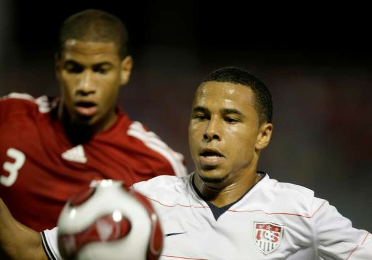 Charlie Davies of the U.S., right, runs for the ball followed byTrinidad and Tobago's Radanfah Abu Bakr during the first half.