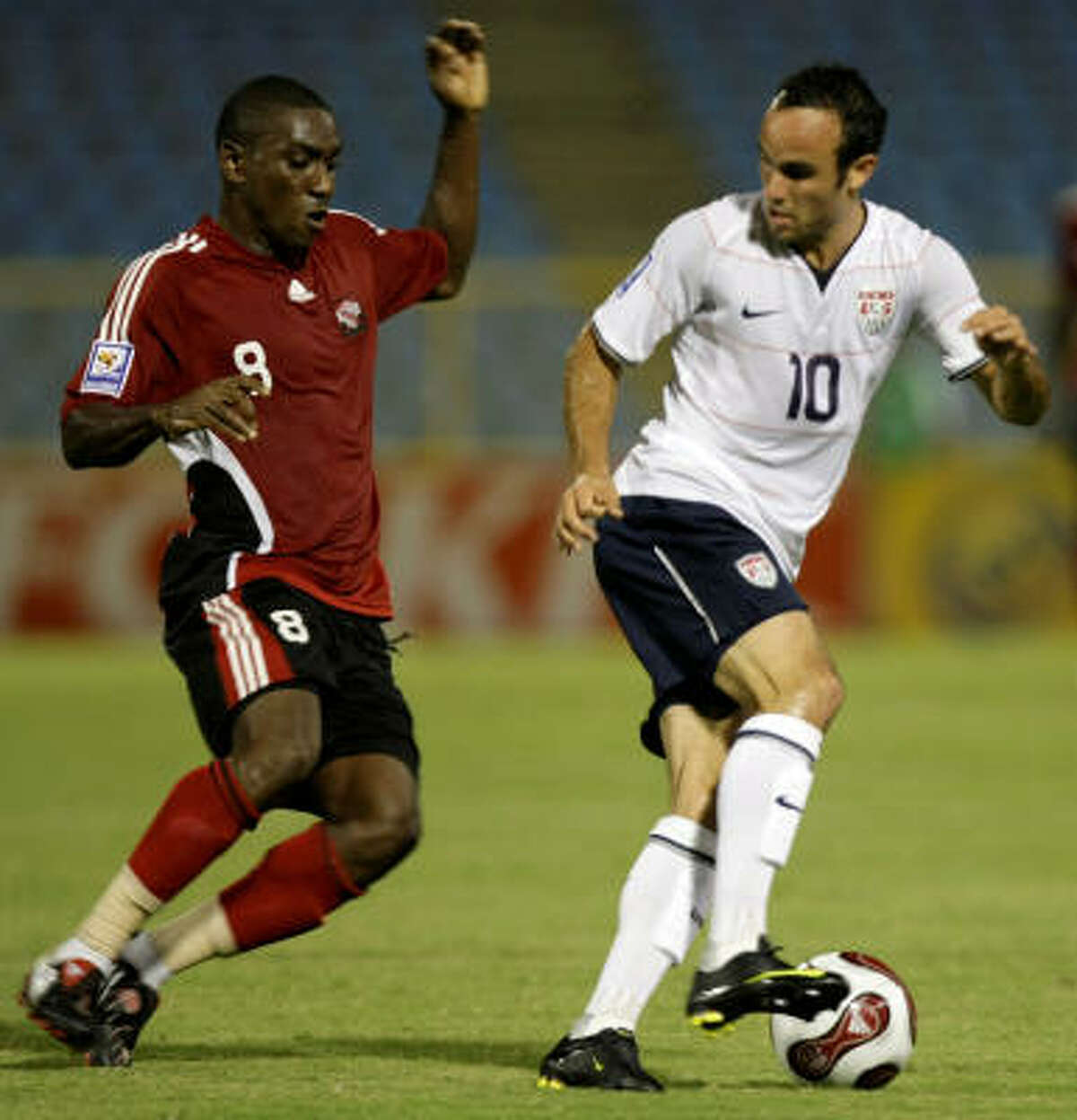U.S. striker Landon Donovan, right, fights for the ball with Trinidad and Tobago's Trent Noel.
