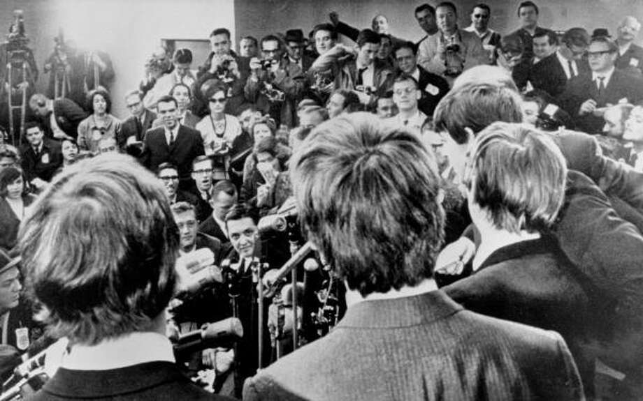 The Beatles face the media at Idlewile Airport (now JFK) in New York after a welcoming by a screaming crowd estimated at 5,000. Photo: AP