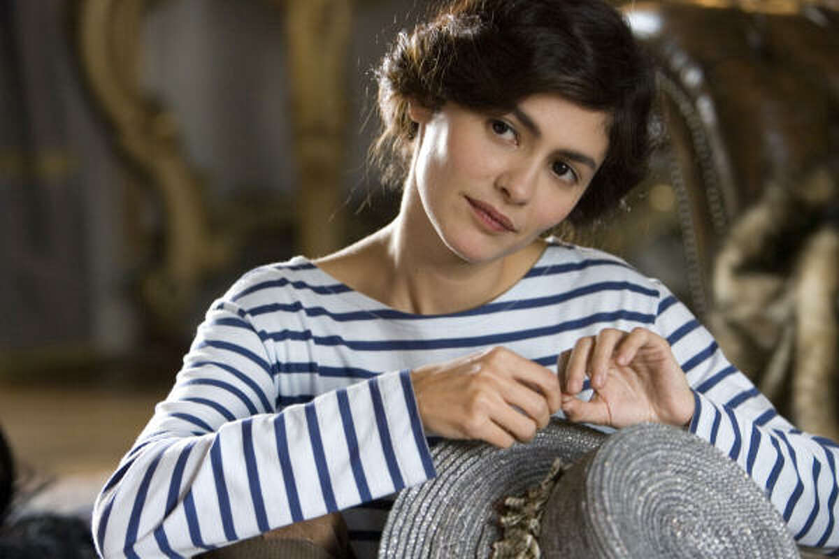 """Launched career After a few years as a not-very-good singer, Chanel took up with a textile heir, with whom she may have had a son. By 1910, she was a milliner. (Pictured is Audrey Tautou in the movie """"Coco Before Chanel)"""