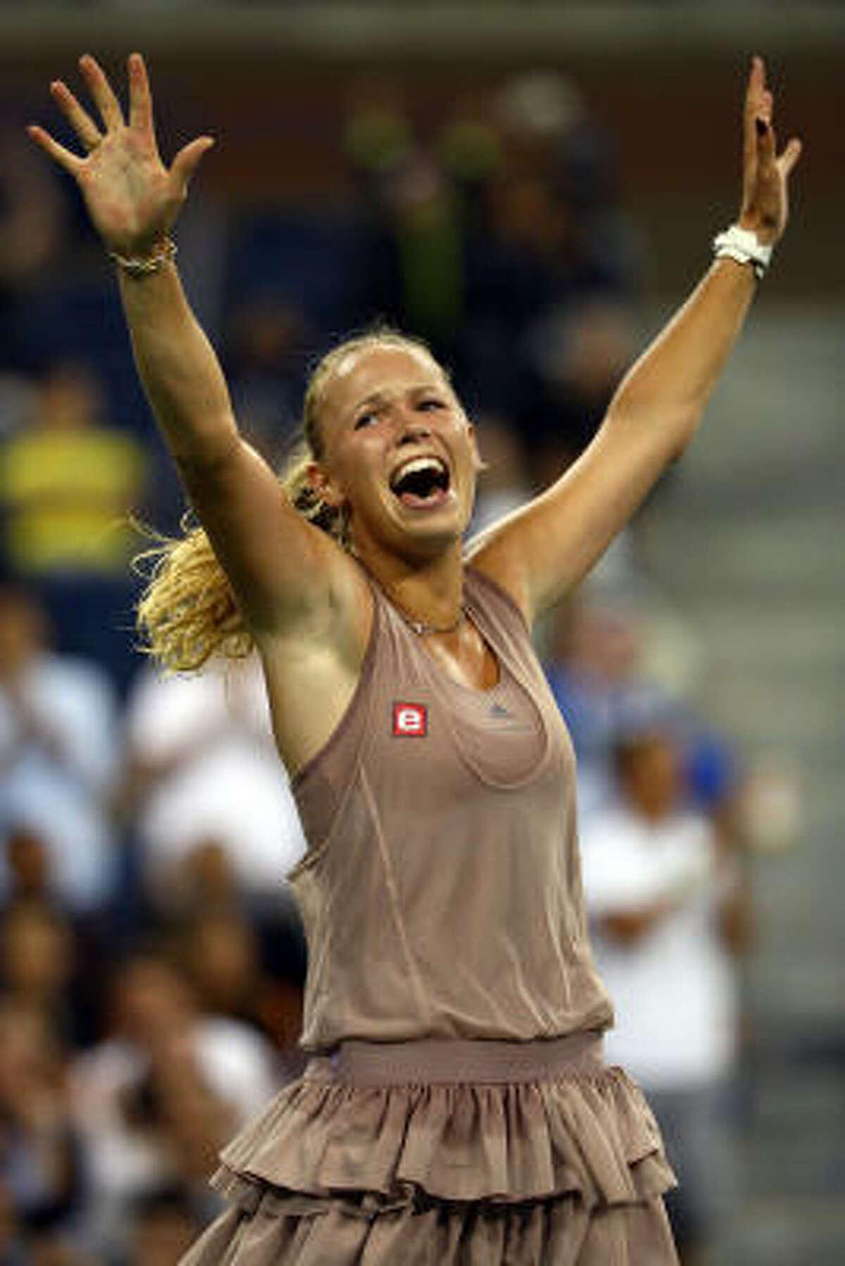 Caroline Wozniacki of Denmark reacts after defeating Svetlana Kuznetsova of Russia.