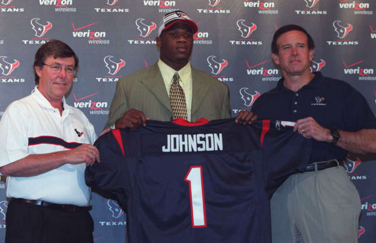 Houston Texans general manager Charley Casserly, left, and head coach Dom Capers, right, welcome their first pick in the NFL draft Andre Johnson, a wide receiver from the University of Miami.