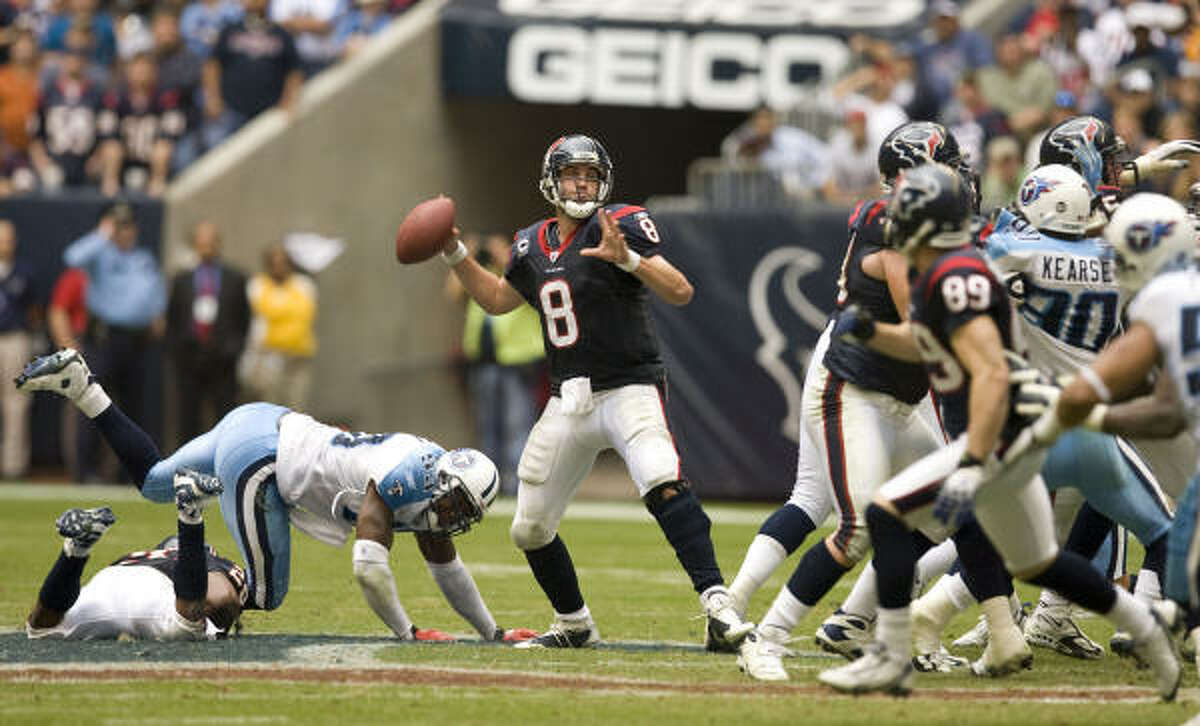 Texans quarterback Matt Schaub, center, throws a pass against the Tennessee Titans during the fourth quarter.