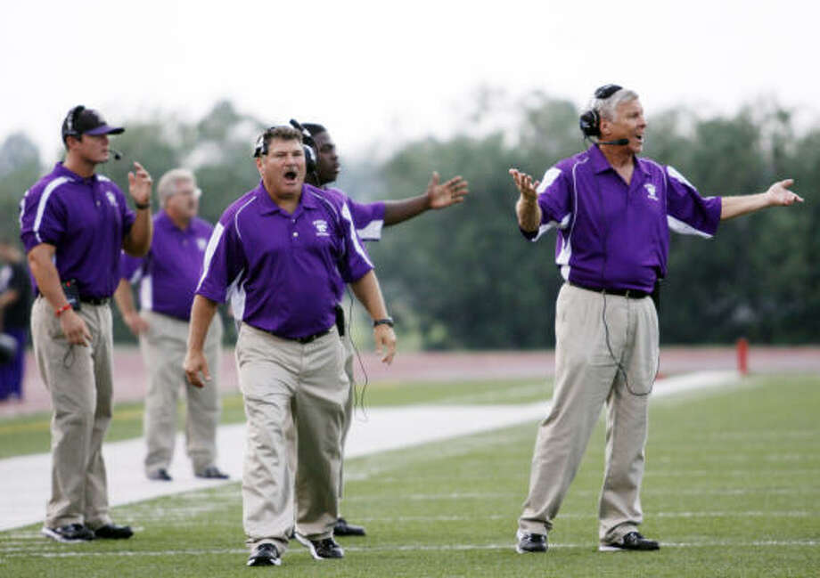 Humble coaches argue with officials as while trailing in the first half against the Spring Lions. Photo: Eric Kayne, For The Chronicle