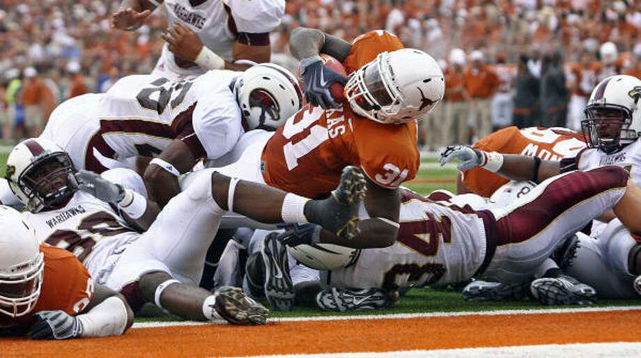 Texas' Cody Johnson scores his second touchdown during the Longhorns' game against Louisiana-Monroe in Austin on Saturday night. Photo: Tom Reel, San Antonio Express-News