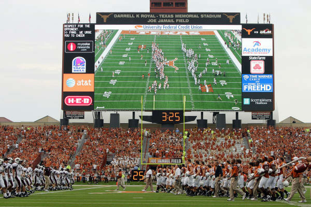 The Texas Longhorns shake hands with the Louisiana Monroe Warhawks at midfield before the game at Royal-Texas Memorial Stadium in Austin.