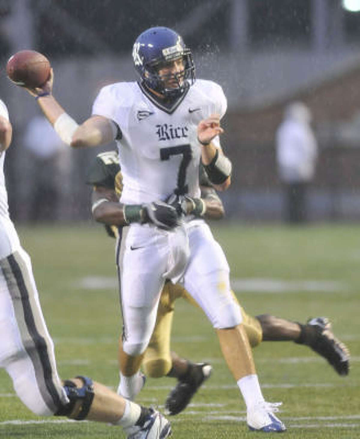Rice quarterback Nick Fanuzzi is hit from behind by UAB's Robert Calhoun as he releases the ball for an incomplete pass.