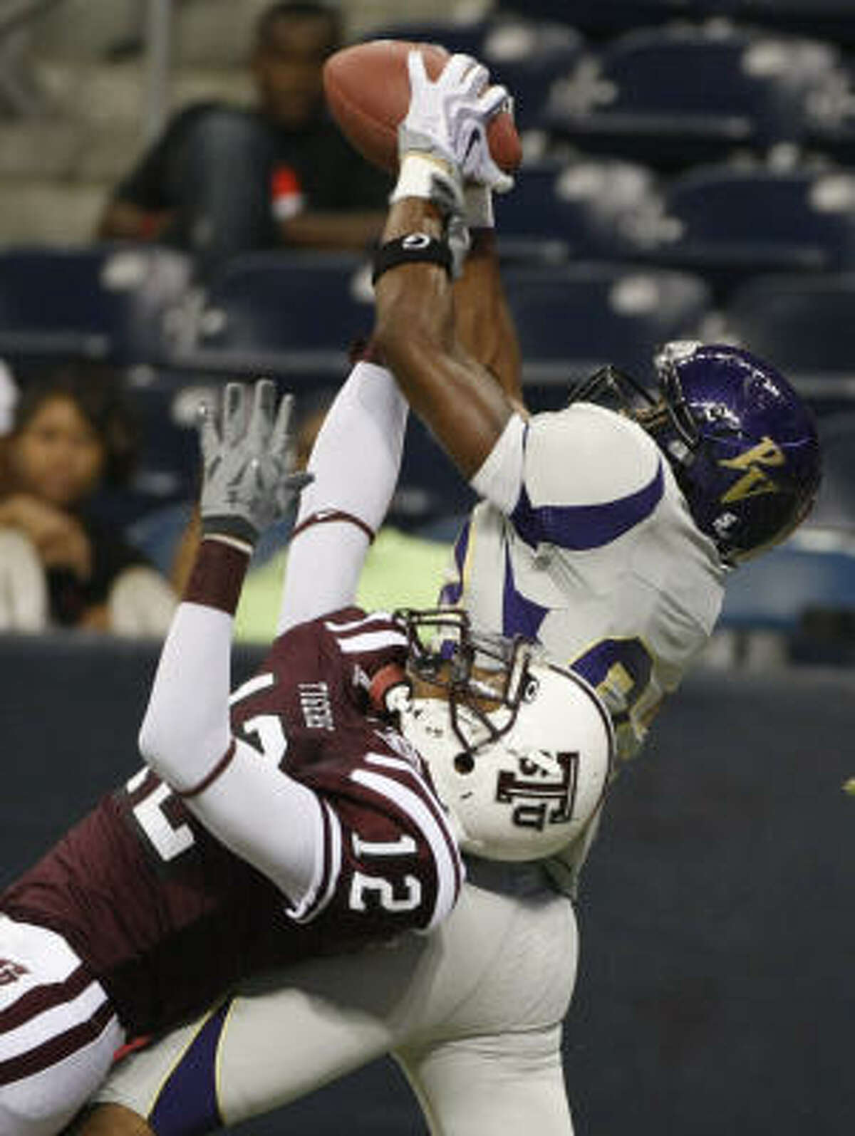 Prairie View A&M's Gabe Osaze-Ediae, top, is able to hold on to the ball for a touchdown as TSU's Anthony Webb tries to defend in the first quarter of Prairie View's 17-7 win.