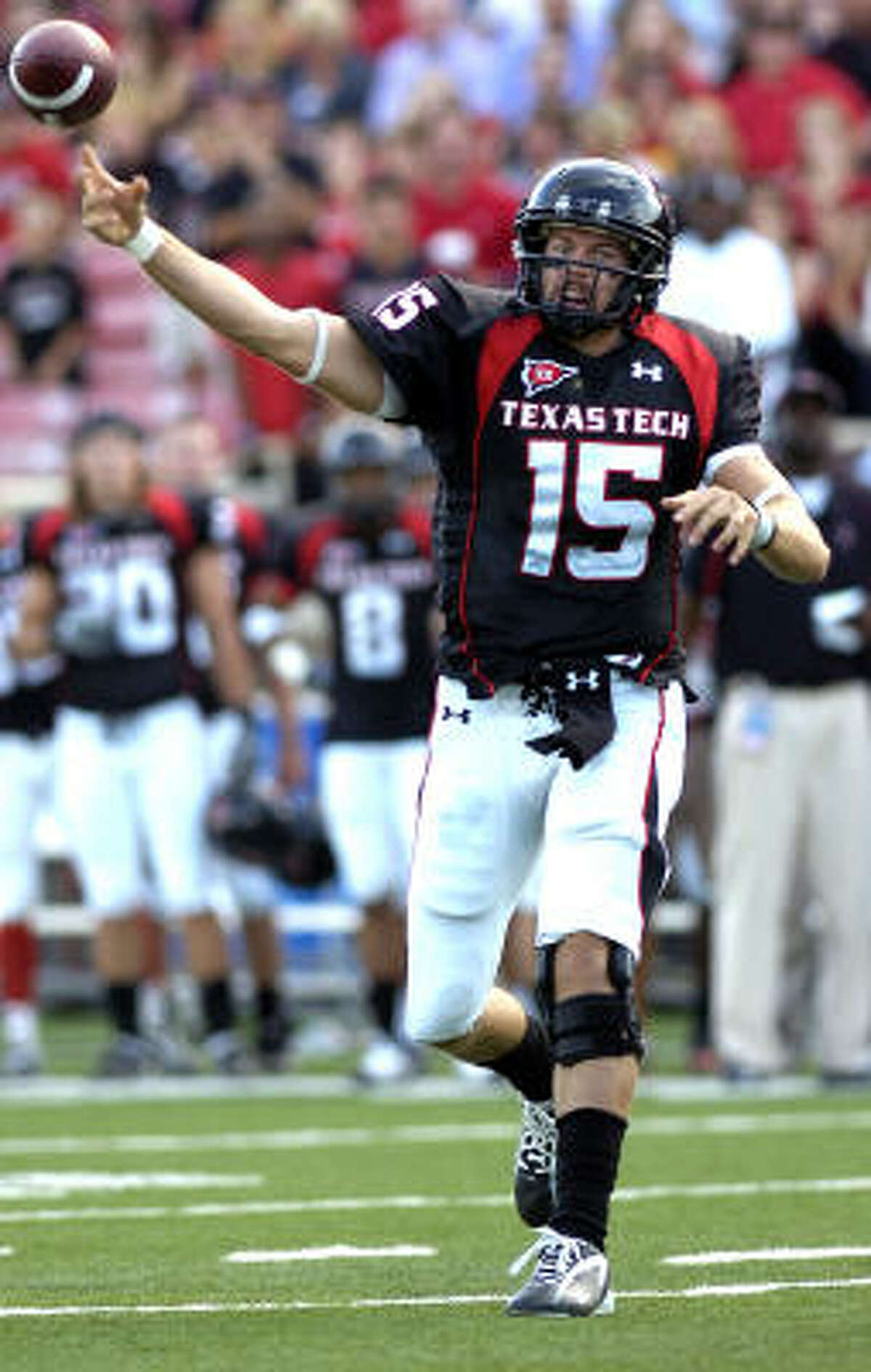 Texas Tech's Taylor Potts throws a pass against North Dakota. Potts threw for 420 yards and two touchdowns to go along with three interceptions.