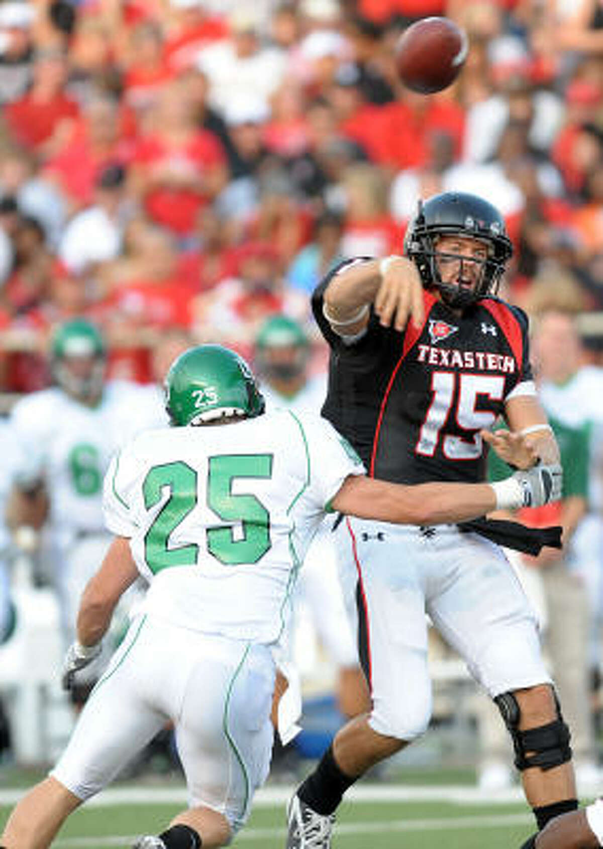 Texas Tech's Taylor Potts, right, throws a pass under pressure from North Dakota's Damon Andrews.