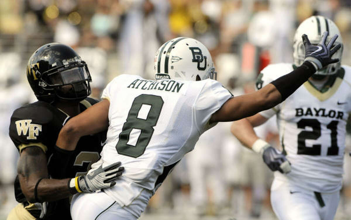 Pass interference is called on Baylor safety Tim Atchison as he defends Wake Forest wide receiver Devon Brown.
