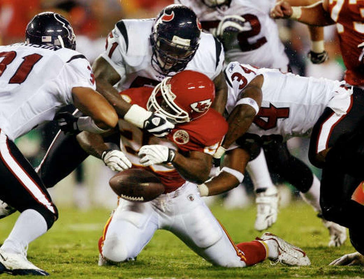 Texans 16, Kansas City Chiefs 10 Chiefs running Back Dantrell Savage fumbles the ball during the preseason game against the Texans at Arrowhead Stadium.