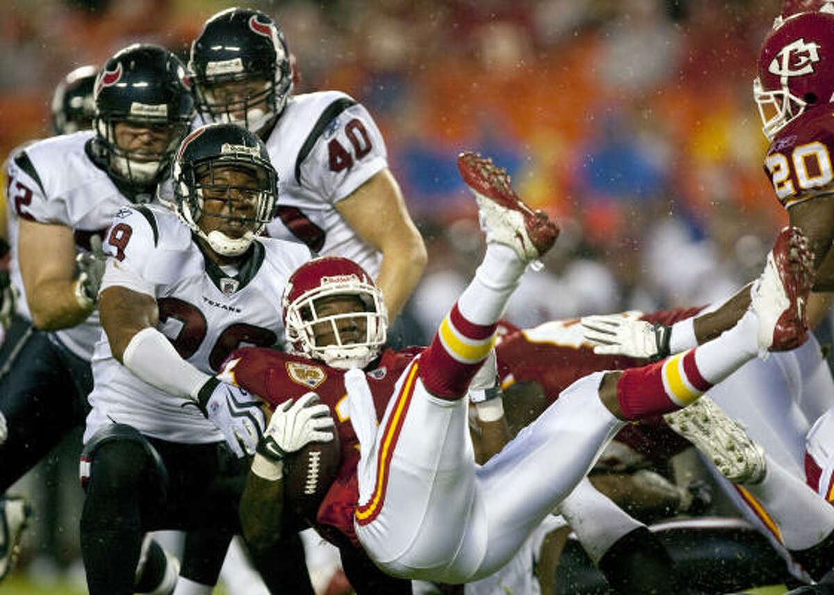 Kansas City Chiefs kick returner Quinten Lawrence is brought down by the Texans' Glover Quin.