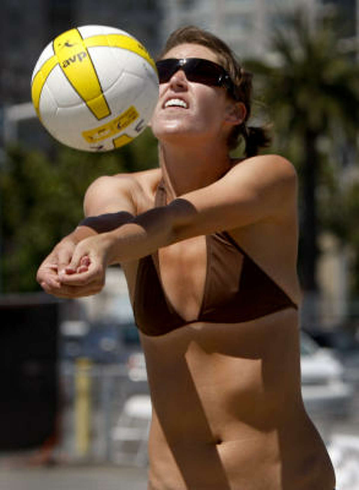 Kyra Lancon sets up her partner Ashley Regner for a shot in a second round match of the AVPNext Championship Cup beach volleyball competition.
