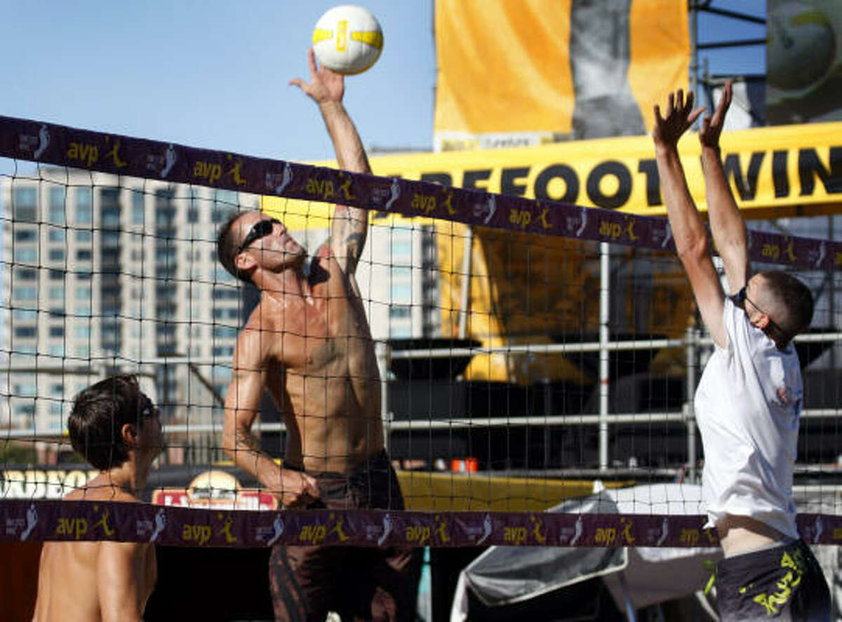 Tim Wooliver spikes the ball past Steve Hennings in the first round of the AVPNext Championship Cup.