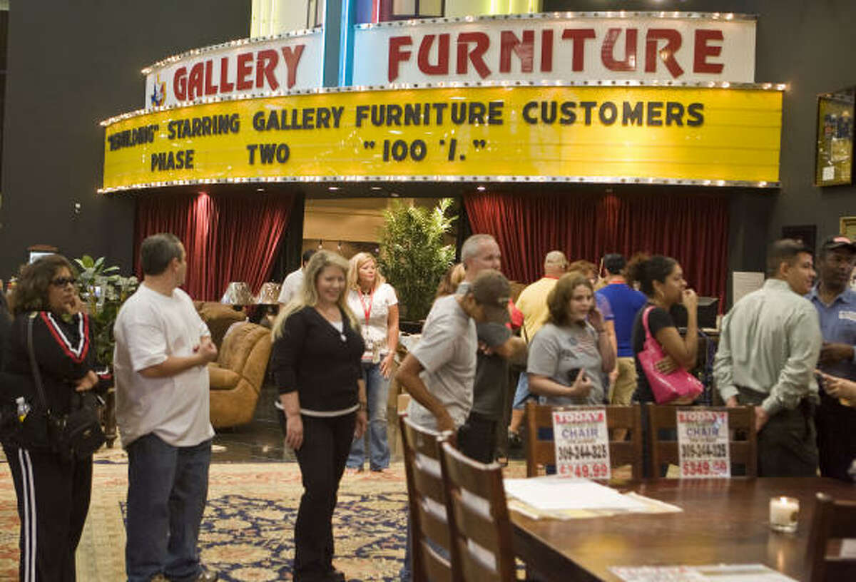 Customers at Gallery Furniture look around during the complete store reopening after the repairs due to an arson fire at the store. Read more here.