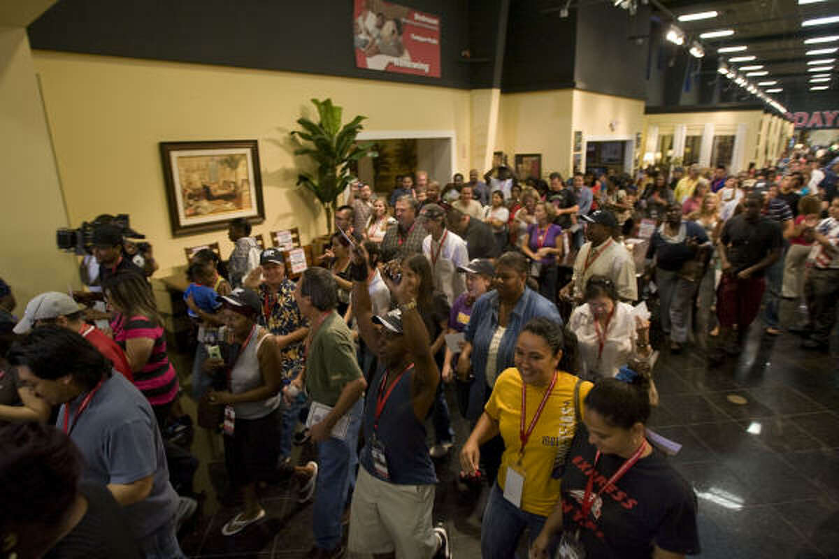 Customers enter Gallery Furniture during the complete store reopening.