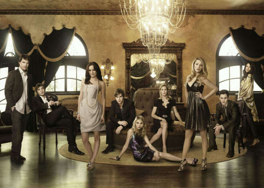 The CW hopes Gossip Girl, starring Matthew Settle, from left, Ed Westwick, Leighton Meester, Chace Crawford, Taylor Momsen, Kelly Rutherford, Blake Lively, Penn Badgley and Jessica Szohr, will continue to attract young female viewers. Photo: The CW