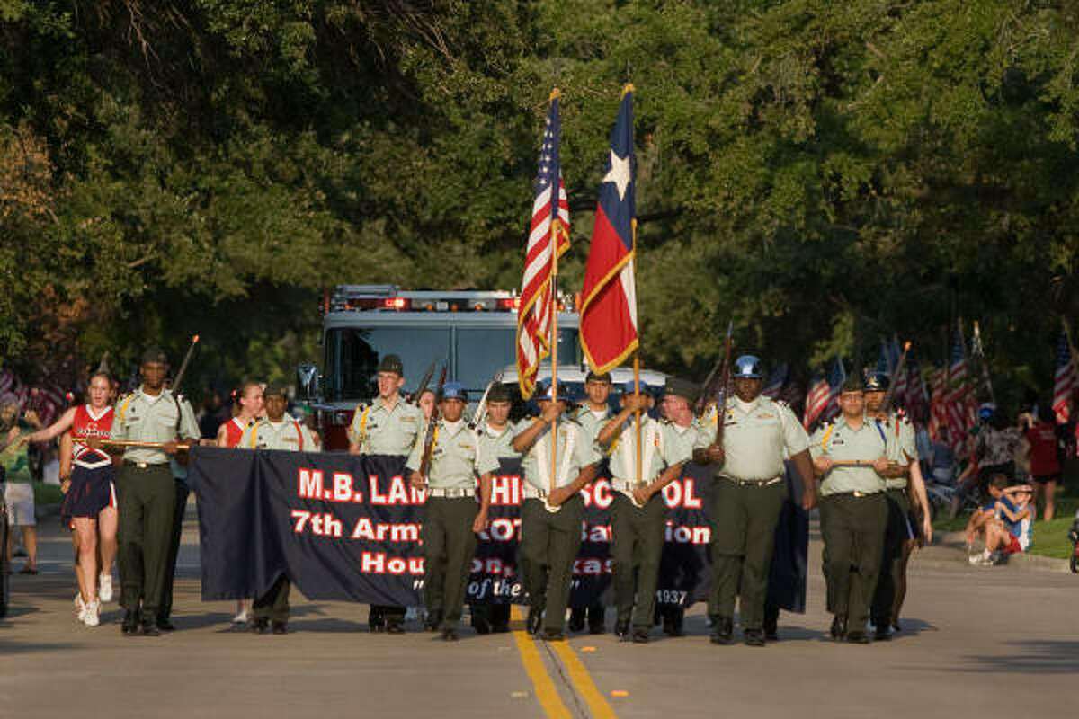 LITTLE LEAGUE WINNNERS: Lamar High School's JROTC Color Guard led the homecoming parade for the West University Place Little League Seniors Team, winners of the 2009 World Series.