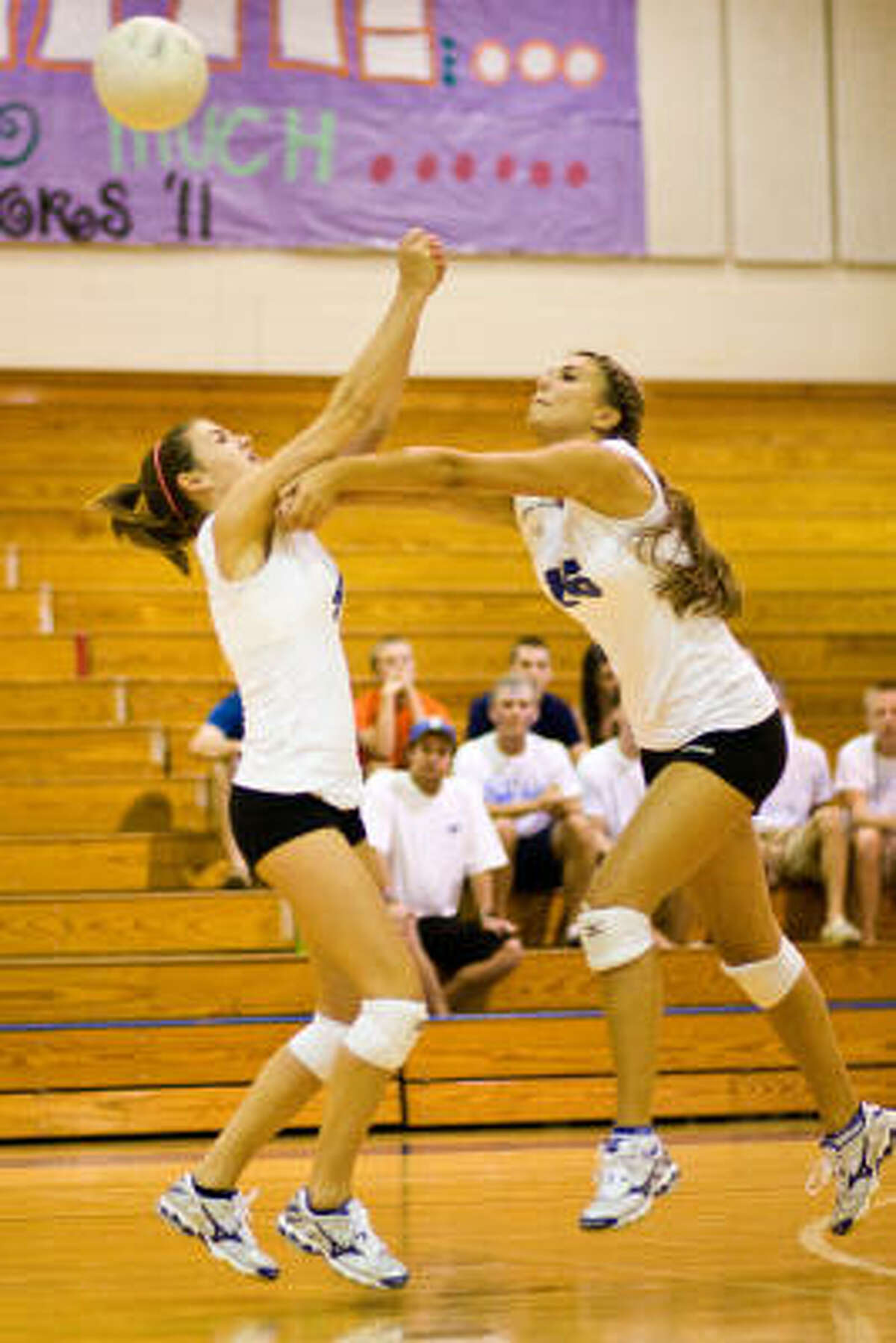 Katy Taylor's Sarah Carithers, left, and Amanda Jungwirth nearly collide going for a pass.