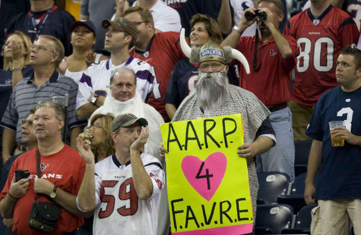 Fans mock the age of Minnesota Vikings quarterback Brett Favre.