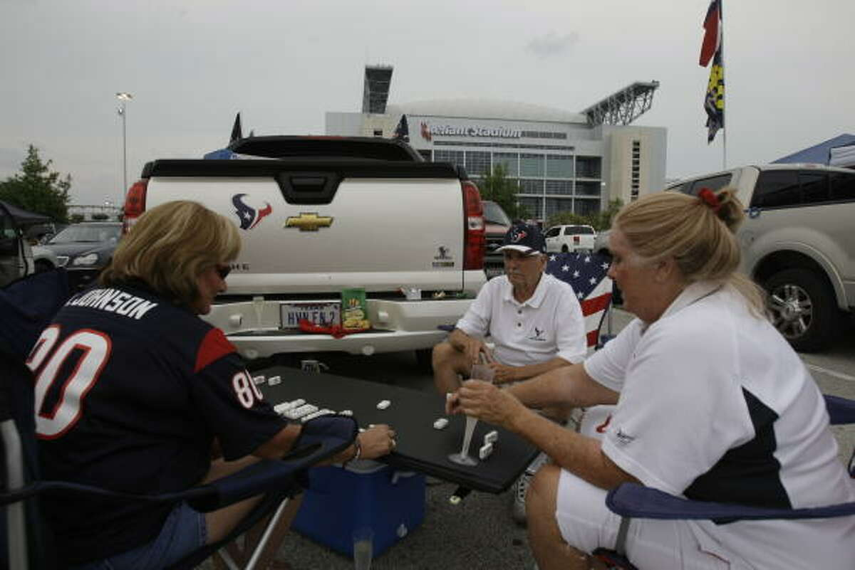 Texans fans play dominos in the parking lot before the preseason game against the Vikings.