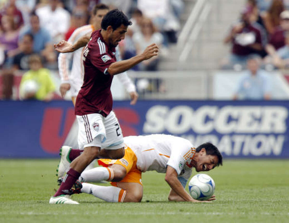 Aug 30: Rapids 1, Dynamo 0 Dynamo forward Brian Ching, right, falls to the ground in pain after being taken down by Colorado Rapids midfielder Pablo Mastroeni in the first half of a Major League Soccer game in Commerce City, Colo.