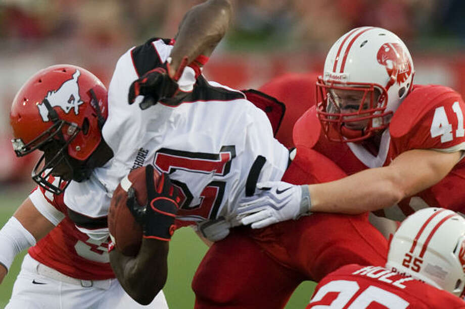North Shore's Tracy Woods is brought down by Katy's Grant Clifton (41) during the first half of Saturday's game. Katy won 9-7, halting North Shore's regular-season winning streak at 78 games. Photo: Smiley N. Pool, Chronicle
