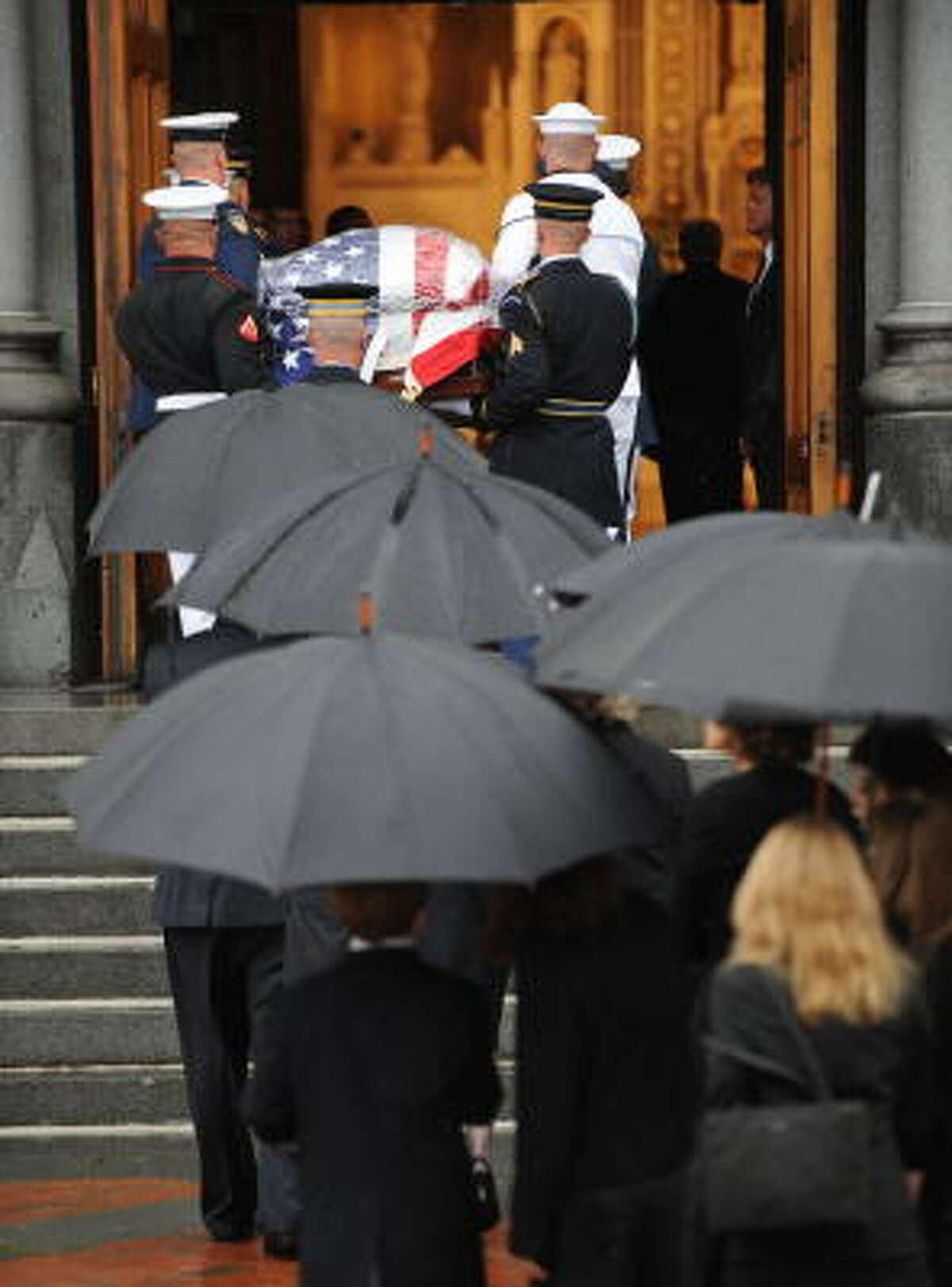 Family members follow the coffin into the service.