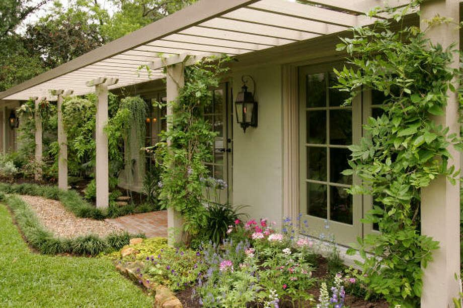 Gardener Pat Hermes designed this pergola.  More: Submit your garden photos | Houston Plant Database | HoustonGrows.com Photo: Bruce Bennett, For The Chronicle