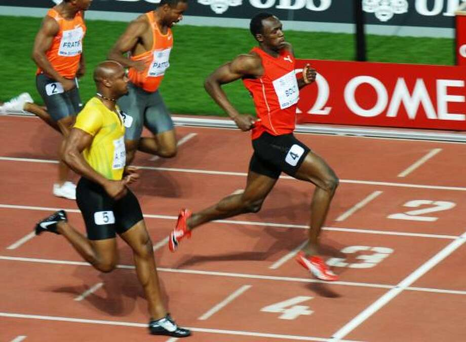 Jamaican Usain Bolt, right, hangs on to win the men's 100 meter race ahead of countryman Asafa Powell on Friday at the Golden League athletics meeting in the Letzigrund stadium in Zurich, Switzerland. Photo: Steffen Schmidt, AP