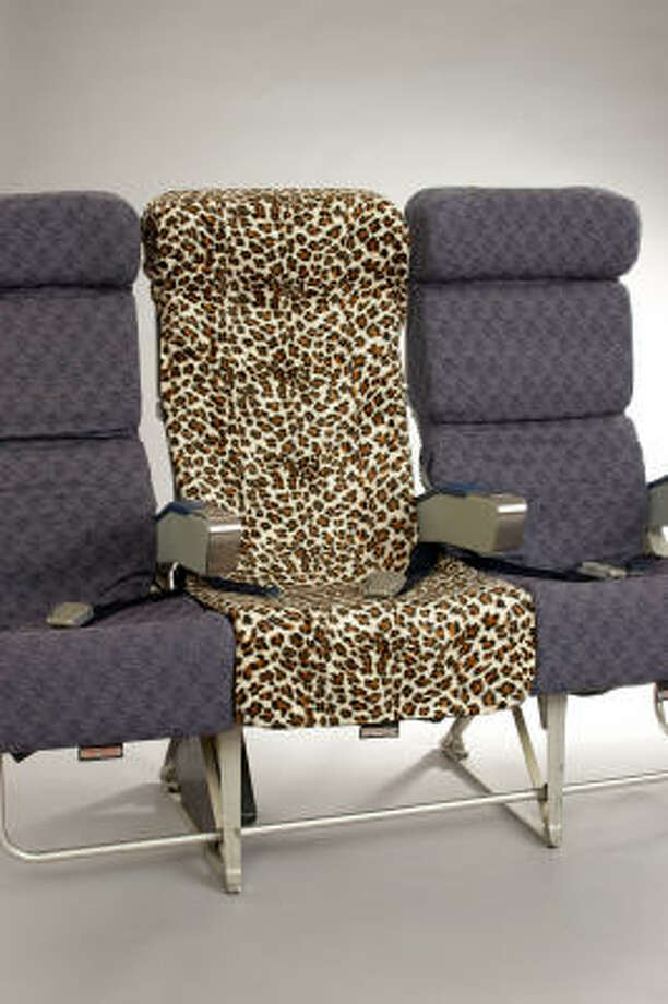 "The makers of PlaneSheets, which come in denim, leopard and camouflage prints, claim they transform ""a tired, overused airline seat into a cozy, happy place."" Photo: PlaneSheets"