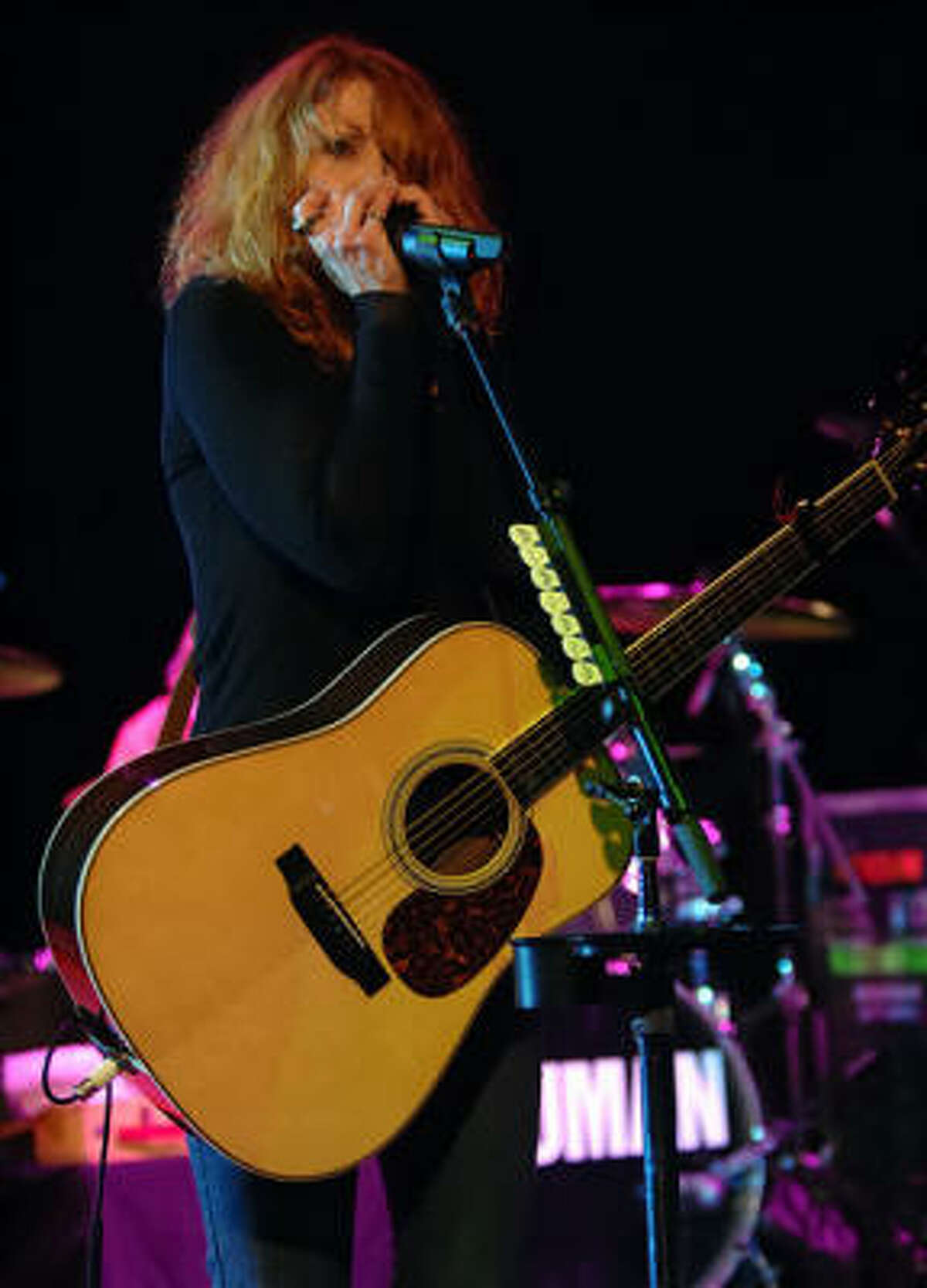 Heart's Nancy Wilson works the harmonica in Houston at the Arena Theater.