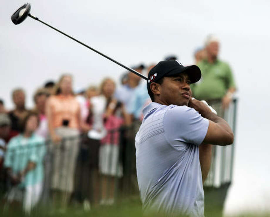 Tiger Woods watches his shot on the 15th hole during the first round of The Barclays golf tournament Thursday in Jersey City, N.J. Woods shot a 1-under 70 in the first round. Photo: Mel Evans, AP
