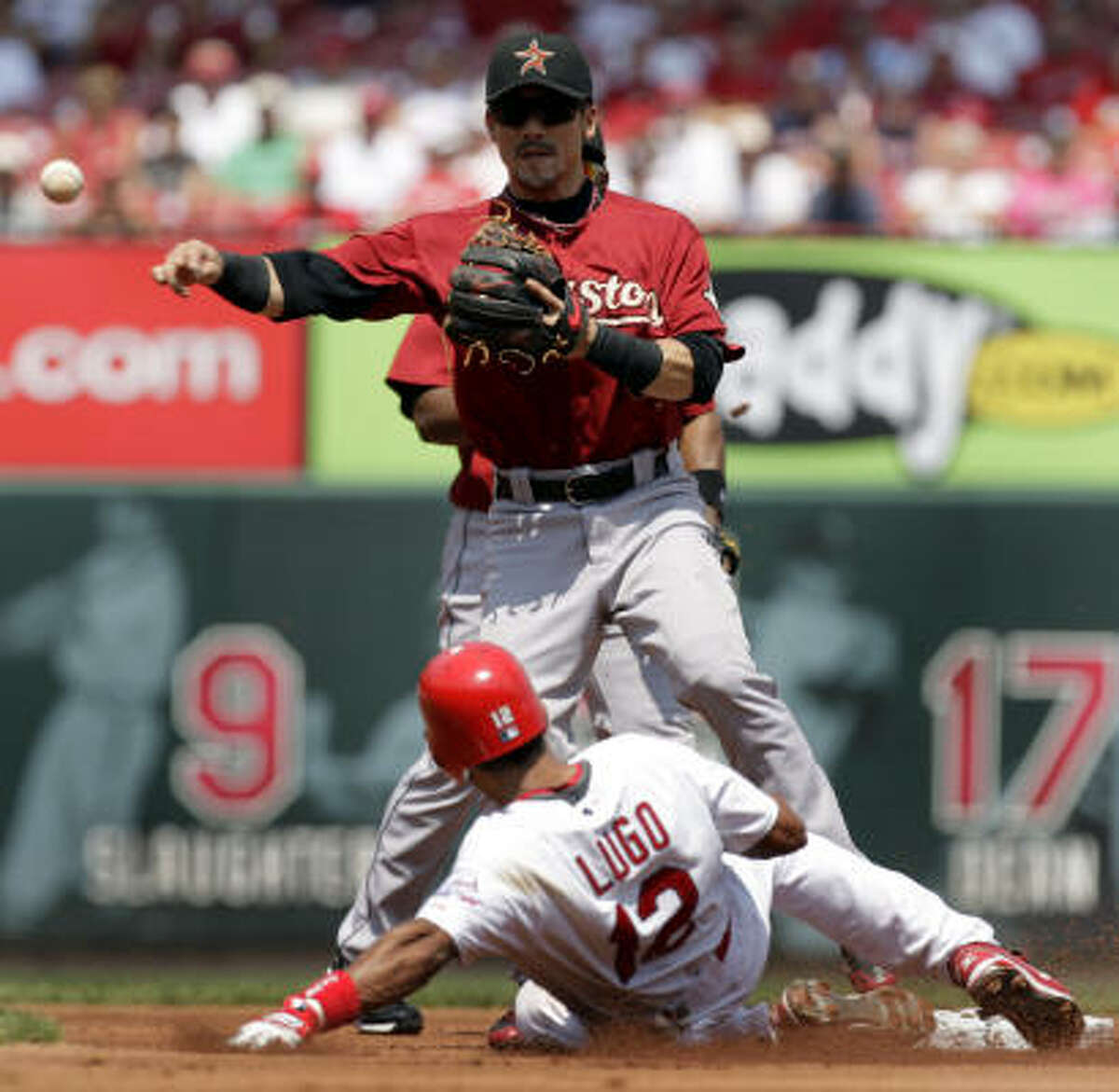 St. Louis' Julio Lugo, bottom, is out at second as Astros second baseman Kazuo Matsui throws to first to complete a double play on Albert Pujols at first during the first inning.