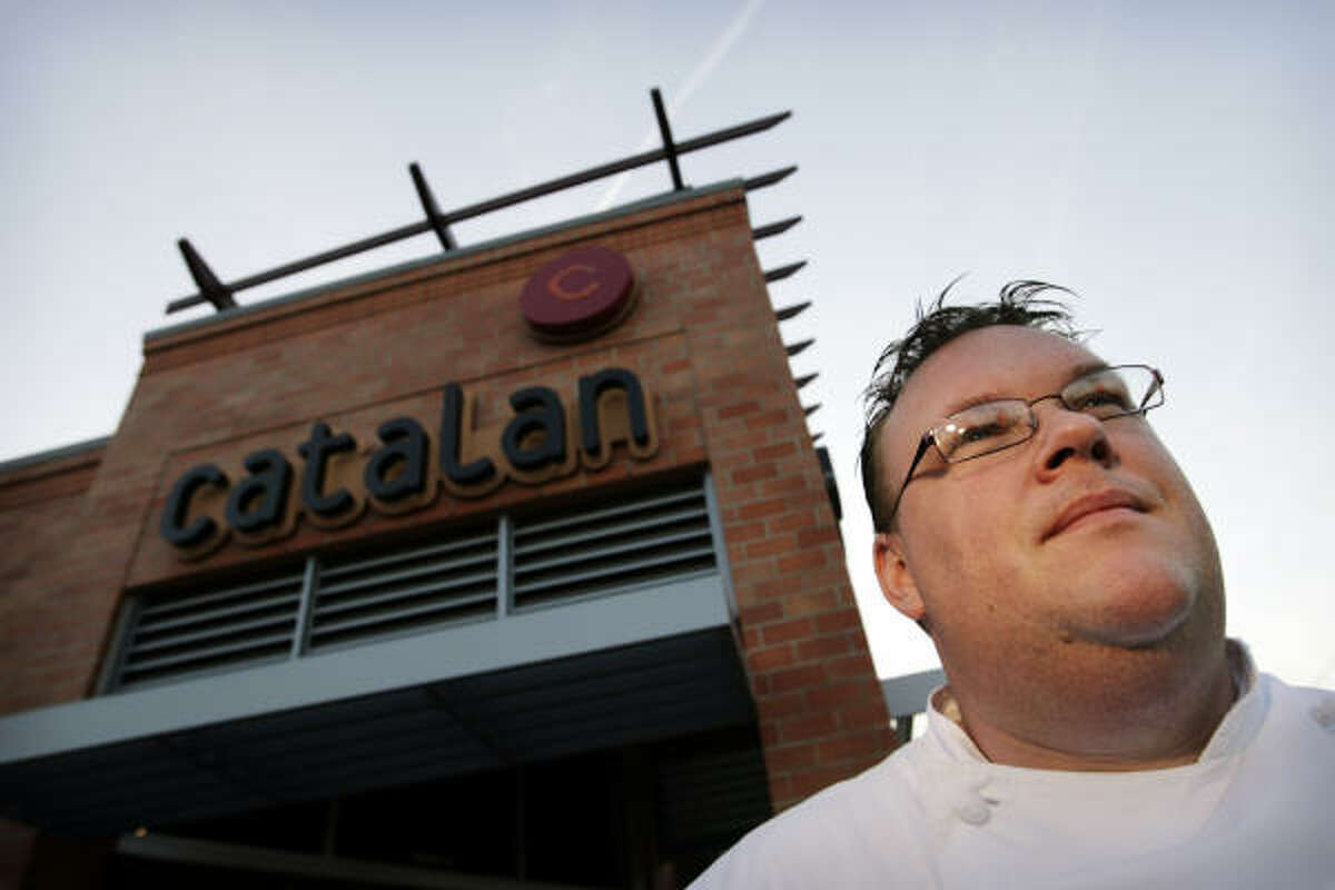 Chef Chris Shepherd stands outside his restaurant Catalan where the Pork Belly Throwdown was recently held. Read more about the competition here.