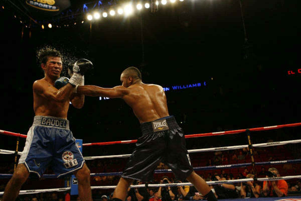 Hylon Williams (right) of Houston hits Baudel Cardenas (left) of Los Mochis, Mexico in a lightweight fight at the Toyota Center.