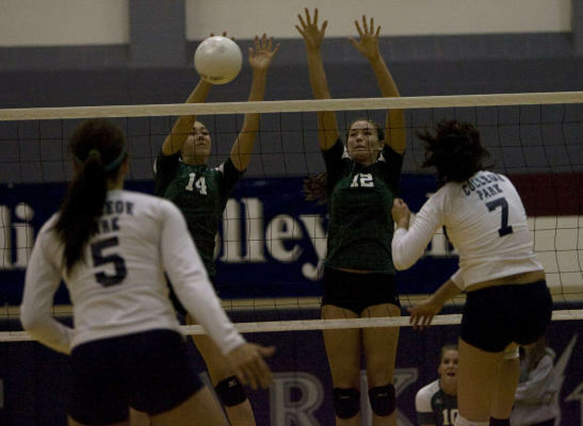 High school volleyball Brenham's Emily Albus (14) and Scout Brooks (12) block a shot from College Park's Lexi Erwin, right, as 4A Brenham defeated 5A College Park 3-1 at College Park High School.