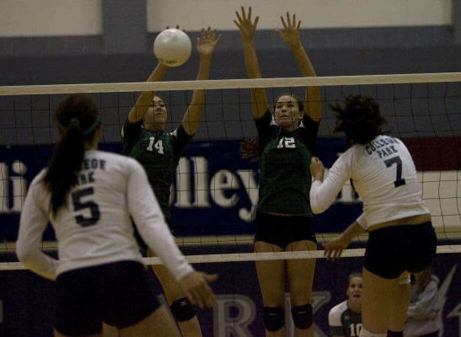 High school volleyballBrenham's Emily Albus (14) and Scout Brooks (12) block a shot from College Park's Lexi Erwin, right, as 4A Brenham defeated 5A College Park 3-1 at College Park High School. Photo: Johnny Hanson, Chronicle