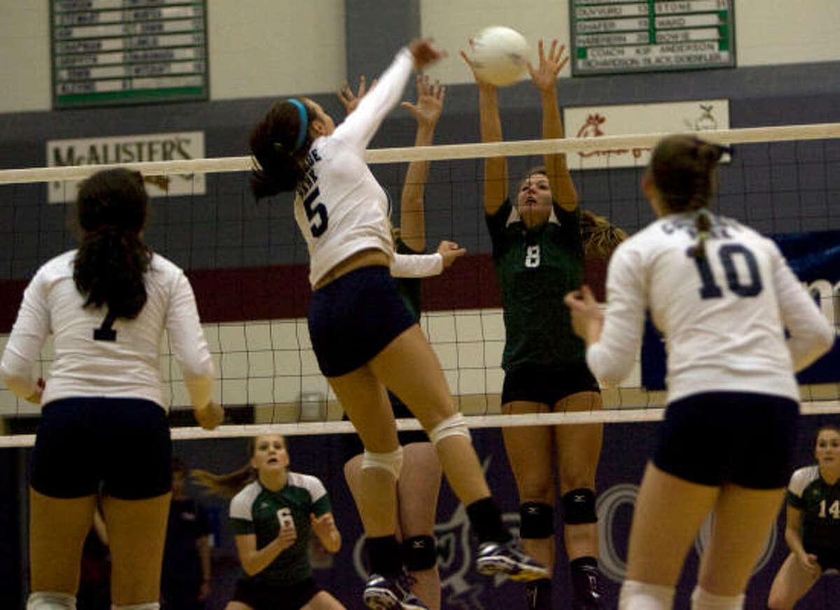 Brenham's Caroline Young (8) goes up to block the shot of College Park's Lauren Chapman, center.