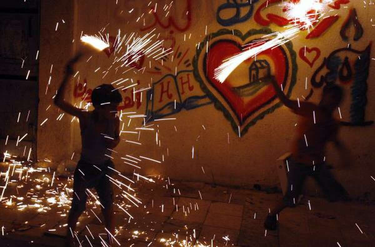 In Gaza City kids play with fireworks after breaking the fast.